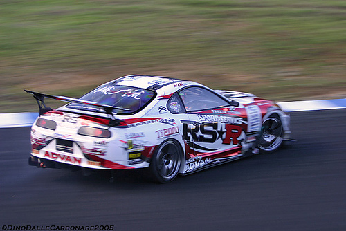 Heavily modified late model Toyota Supra with eye catching sponsor graphics