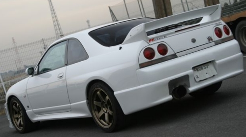 White two door Japanese supercar