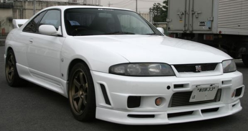 Japanese import two door coupe in white