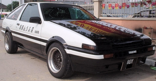 Small black and white 1980's Japanese import car